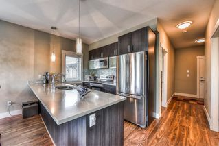 "Main Photo: 207 5665 177B Street in Surrey: Cloverdale BC Condo for sale in ""LINGO"" (Cloverdale)  : MLS®# R2334719"