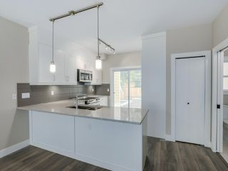 """Photo 9: 401 1405 DAYTON Avenue in Coquitlam: Burke Mountain Townhouse for sale in """"ERICA"""" : MLS®# R2084326"""