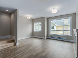 """Photo 11: 401 1405 DAYTON Avenue in Coquitlam: Burke Mountain Townhouse for sale in """"ERICA"""" : MLS®# R2084326"""