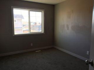 Photo 11: 2408 SPARROW Crescent in Edmonton: Zone 59 House Half Duplex for sale : MLS®# E4143277