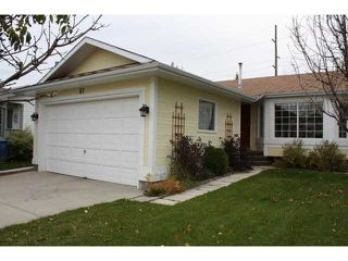 Main Photo: 61 SHAWINIGAN Way SW in CALGARY: Shawnessy Residential Detached Single Family for sale (Calgary)  : MLS®# C3500368