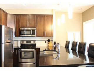 Photo 2: 209 22 PANATELLA Road NW in : Panorama Hills Condo for sale (Calgary)  : MLS®# C3586626