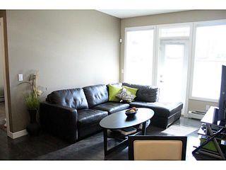Photo 5: 209 22 PANATELLA Road NW in : Panorama Hills Condo for sale (Calgary)  : MLS®# C3586626