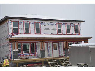 """Main Photo: 9219 102 Avenue in Fort St. John: Fort St. John - City NE House 1/2 Duplex for sale in """"S"""" (Fort St. John (Zone 60))  : MLS®# N232084"""