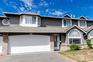 "Photo 1: 108 6109 W BOUNDARY Drive in Surrey: Panorama Ridge Townhouse for sale in ""Lakewood Gardens"" : MLS®# R2197585"