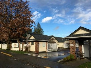 "Photo 1: 98 19649 53 Avenue in Langley: Langley City Townhouse for sale in ""Huntsfield Green"" : MLS®# R2224007"