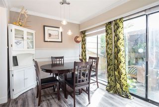 """Photo 1: 52 10545 153 Street in Surrey: Guildford Townhouse for sale in """"Guildford Mews"""" (North Surrey)  : MLS®# R2294818"""