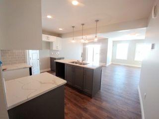 Main Photo: 5708 Hawthorn Common in Edmonton: Zone 53 House Half Duplex for sale : MLS®# E4135971