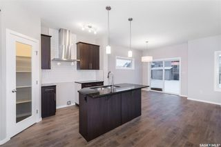 Photo 2: 406 Hassard Close in Saskatoon: Kensington Residential for sale : MLS®# SK754921