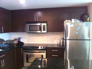 Photo 2: 203 555 Delestre Avenue in Coquitlam: Condo for sale : MLS®# V1028408