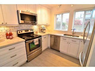 """Photo 2: 101 1860 W 6TH Avenue in Vancouver: Kitsilano Townhouse for sale in """"Heritage on Cypress"""" (Vancouver West)  : MLS®# V1058606"""