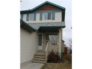 Photo 2: 7820 LAGUNA Way NE in CALGARY: Monterey Park Residential Detached Single Family for sale (Calgary)  : MLS®# C3611607
