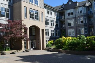 "Photo 1: 213 20200 56 Avenue in Langley: Langley City Condo for sale in ""THE BENTLEY"" : MLS®# R2068739"