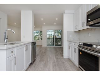 """Photo 1: 595 CARLSEN Place in Port Moody: North Shore Pt Moody Townhouse for sale in """"EAGLE POINTE"""" : MLS®# R2227952"""