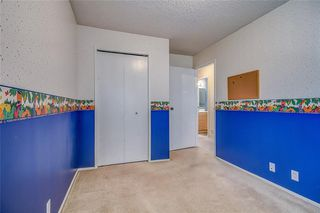 Photo 27: 145 WOODSMAN Lane SW in Calgary: Woodbine Row/Townhouse for sale : MLS®# C4303483