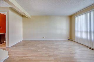 Photo 7: 145 WOODSMAN Lane SW in Calgary: Woodbine Row/Townhouse for sale : MLS®# C4303483