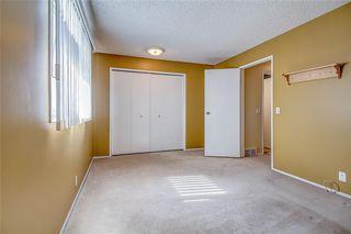 Photo 18: 145 WOODSMAN Lane SW in Calgary: Woodbine Row/Townhouse for sale : MLS®# C4303483
