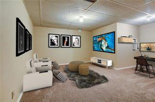 Photo 29: 145 WOODSMAN Lane SW in Calgary: Woodbine Row/Townhouse for sale : MLS®# C4303483