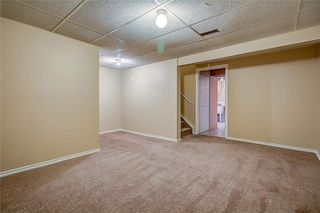 Photo 30: 145 WOODSMAN Lane SW in Calgary: Woodbine Row/Townhouse for sale : MLS®# C4303483