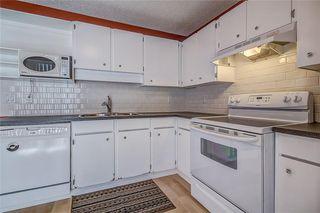 Photo 14: 145 WOODSMAN Lane SW in Calgary: Woodbine Row/Townhouse for sale : MLS®# C4303483