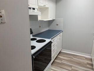 Photo 4: 403 2520 Palliser Drive SW in Calgary: Oakridge Row/Townhouse for sale : MLS®# A1016758