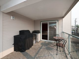 "Photo 18: 209 6390 196 Street in Langley: Willoughby Heights Condo for sale in ""Willow Gate"" : MLS®# R2195681"