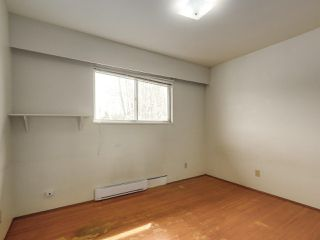 Photo 7: 7038 ELMHURST Drive in Vancouver: Fraserview VE House for sale (Vancouver East)  : MLS®# R2259485