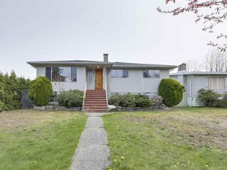 Photo 1: 7038 ELMHURST Drive in Vancouver: Fraserview VE House for sale (Vancouver East)  : MLS®# R2259485