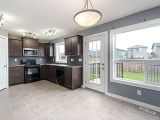 Photo 12: 2513 RAVENSWOOD View SE: Airdrie House for sale : MLS®# C4194180