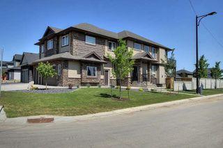 Photo 1: 1254 Adamson Drive in Edmonton: Zone 55 Attached Home for sale : MLS®# E4145978