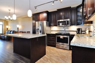 Photo 2: A403 8218 207A Street in Langley: Willoughby Heights Condo for sale : MLS®# R2516998