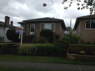 Photo 1: 2576 E 24TH Avenue in Vancouver: Renfrew Heights House for sale (Vancouver East)  : MLS®# V1072343