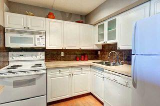 Photo 3: 905 735 12 Avenue SW in Calgary: Connaught Condo for sale : MLS®# C3642862