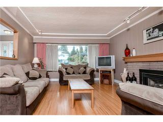 Photo 4: 643 CLAREMONT Street in Coquitlam: Coquitlam West House for sale : MLS®# V1113978