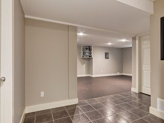 Photo 33: 1613 STRATHCONA Drive SW in Calgary: Strathcona Park House for sale : MLS®# C4005151