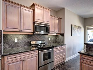 Photo 4: 1613 STRATHCONA Drive SW in Calgary: Strathcona Park House for sale : MLS®# C4005151
