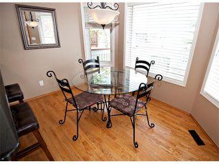 Photo 11: 60 DOUGLASVIEW Rise SE in Calgary: Douglasdale Estates House for sale : MLS®# C4012929