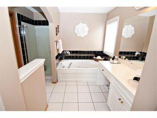 Photo 20: 60 DOUGLASVIEW Rise SE in Calgary: Douglasdale Estates House for sale : MLS®# C4012929