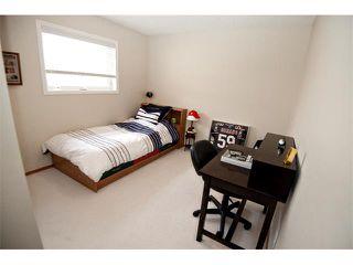 Photo 17: 60 DOUGLASVIEW Rise SE in Calgary: Douglasdale Estates House for sale : MLS®# C4012929