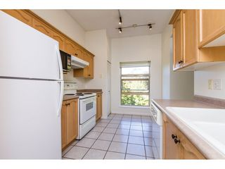 "Photo 8: 409 301 MAUDE Road in Port Moody: North Shore Pt Moody Condo for sale in ""HERITAGE GRAND"" : MLS®# R2102815"