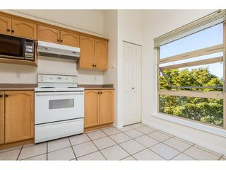 "Photo 9: 409 301 MAUDE Road in Port Moody: North Shore Pt Moody Condo for sale in ""HERITAGE GRAND"" : MLS®# R2102815"