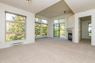 "Photo 1: 409 301 MAUDE Road in Port Moody: North Shore Pt Moody Condo for sale in ""HERITAGE GRAND"" : MLS®# R2102815"