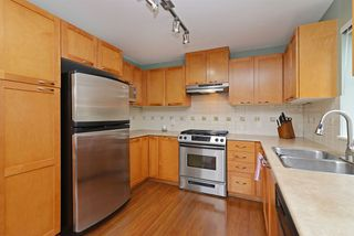 "Photo 2: 211 2958 WHISPER Way in Coquitlam: Westwood Plateau Condo for sale in ""SUMMERLIN"" : MLS®# R2352133"