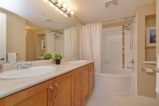 "Photo 14: 211 2958 WHISPER Way in Coquitlam: Westwood Plateau Condo for sale in ""SUMMERLIN"" : MLS®# R2352133"