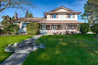 Photo 1: 7129 BUFFALO Street in Burnaby: Government Road House for sale (Burnaby North)  : MLS®# R2032643