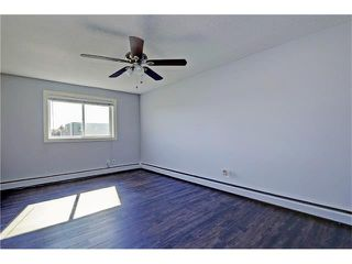 Photo 12: 109 3809 45 Street SW in Calgary: Glenbrook House for sale : MLS®# C4066213