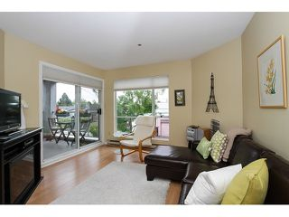 "Photo 1: 303 3505 W BROADWAY in Vancouver: Kitsilano Condo for sale in ""COLLINGWOOD PLACE"" (Vancouver West)  : MLS®# R2086967"