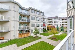 """Photo 2: 404 8142 120A Street in Surrey: Queen Mary Park Surrey Condo for sale in """"STIRLING COURT"""" : MLS®# R2246677"""