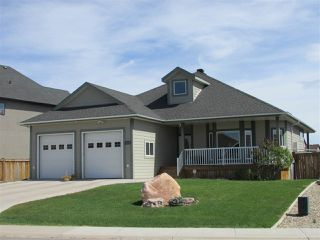"""Photo 1: 11111 88 Street in Fort St. John: Fort St. John - City NE House for sale in """"WHISPERING WINDS"""" (Fort St. John (Zone 60))  : MLS®# R2250380"""