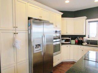 """Photo 4: 11111 88 Street in Fort St. John: Fort St. John - City NE House for sale in """"WHISPERING WINDS"""" (Fort St. John (Zone 60))  : MLS®# R2250380"""